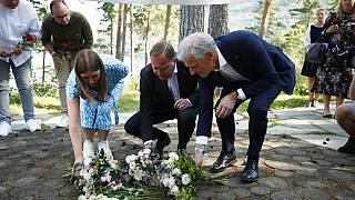 Astrid Hoem, leader of the AUF in Norway, Prime Minister of Sweden Stefan Lofven and Labor Party leader Jonas Gahr Store lay flowers at Utøya