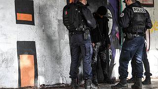 Des policiers contrôlent un homme à Sarcelles, au nord de Paris, le 3 février 2021.