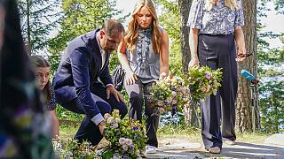 Crown Prince Hakon and Princess Ingrid Alexandra lay flowers at the memorial service on Utoya