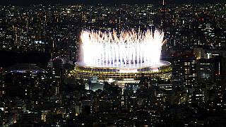 Fireworks illuminate over National Stadium during the opening ceremony of 2020 Tokyo Olympics, July 23, 2021, in Tokyo.
