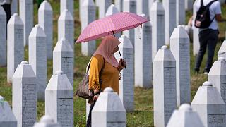 A woman visits the memorial cemetery in Potocari near Srebrenica.