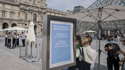 Visitors register for COVID-19 tests at the Louvre museum in Paris.