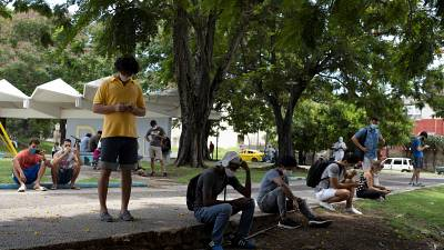 Cubans connect to wifi in Martyrs Park, Havana