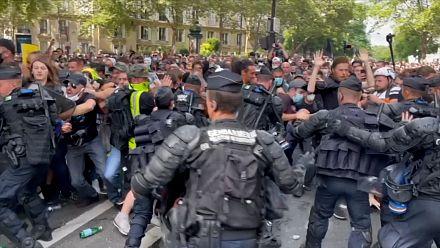Clashes at Paris protest over virus passes