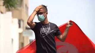 Anti-government demonstrator rallying in front of the Parliament in the capital Tunis