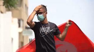 Tunisian anti-government demonstrators rally in Tunis