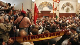 Scores of protesters broke through a police cordon and entered Macedonian parliament in April 2017.