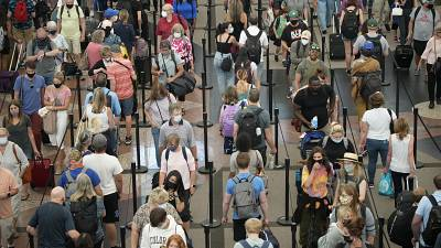 Travellers queue at security checkpoint, Denver International Airport, 16 June 2021