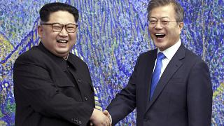 North Korean leader Kim Jong Un (L) and South Korean President Moon Jae-in inside the Peace House at the border village of Panmunjom in Demilitarized Zone, April 28, 2018.