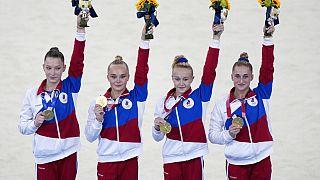 Russian Olympic Committee's artistic gymnastics women's team, from right, Liliia Akhaimova, Viktoriia Listunova, Angelina Melnikova and Vladislava Urazova celebrate.