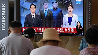 A news program at the Seoul Railway Station in Seoul, South Korea, Tuesday, July 27, 2021.