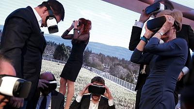 Mark Zuckerberg (centre) and others wear VR headsets at an event in 2016