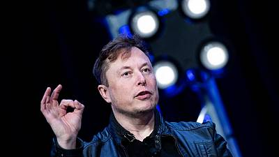 Elon Musk's electric carmaker posted a record quarterly profit on Monday