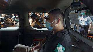 Tong Ying-kit arrives at court in a police van in Hong Kong in July 2020.