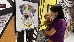 Exhibition for dogs displays artwork at their eye-level
