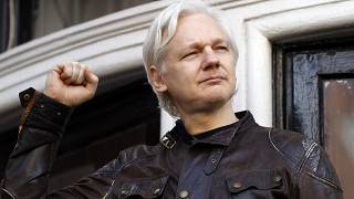 Julian Assange greets supporters outside the Ecuadorian embassy in London on May 19, 2017.