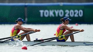 Ancuta Bodnar and Simona Radis of Romania compete in the women's rowing double sculls final at the 2020 Summer Olympics, July 28, 2021, in Tokyo, Japan.