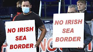 Loyalists opposed to the Northern Ireland Protocol protest in Newtownards town centre, Northern Ireland, Friday, June 18, 2021.