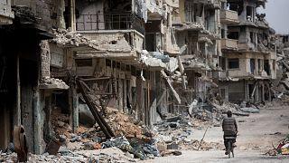 Suriye'de 10 yılı aşkın süredir devam eden iç savaştan geriye yıkılmış binlerce ev kaldı. Humus/Suriye