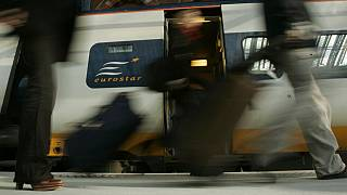 FILE: Travellers get off the first train into St Pancras International station in London, Wednesday Nov. 14, 2007.