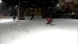 People throwing snow balls at each other.
