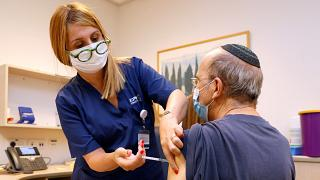 A man receives a third dose of the Pfizer-BioNTech COVID-19 coronavirus vaccine