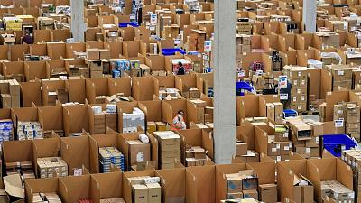Amazon warehouse workers collect goods for thousands of purchase orders containing unrecyclable plastic
