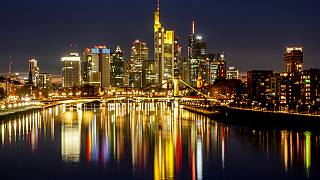 The lights of the bridges and buildings are reflected in the river Main in Frankfurt, Germany. Europe's economy has rebounded into growth in the second quarter of 2021