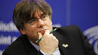 Catalan leader Carles Puigdemont reacts during a press conference at the European Parliament in Strasbourg