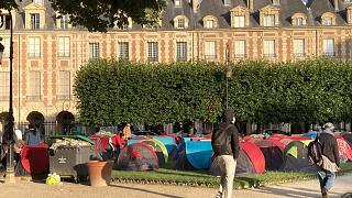 Homleless people in tents on the Place des Vosges in Paris on the morning of July 30, 2021.