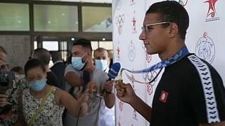 Tunisie : retour triomphal pour le champion olympique Ahmed Hafnaoui
