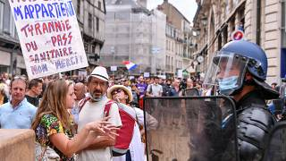 Plans for vaccine passes provoke protests in France, Switzerland and Italy