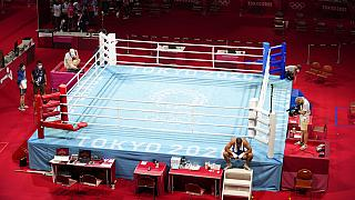 Eliad Mourad, of France refuses to leave the ring after losing a men's super heavyweight over 91-kg boxing match against Britain's Frazer Clarke at the 2020 Summer Olympics.