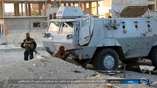 FILE - Photo posted by the Islamic State Group in Sinai shows a deadly attack by militants