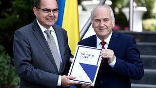 Christian Schmidt, new head of Bosnia's Office of the High Representative or OHR (L) with Valentin Inzko, during a ceremony Sarajevo, Bosnia, Aug. 2, 2021.