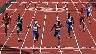 Karsten Warholm, of Norway, third left, celebrates as he wins the gold medal ahead of Rai Benjamin, of United States in the final of the men's 400-meter hurdles