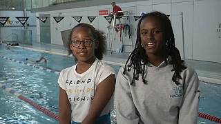 Spotlight beams on swimming caps for people of colour
