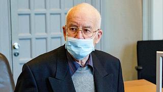 FILE - In this May 28, 2021 file photo a 84-year-old, accused of possession of a tank, waits in the courtroom for the start of the trial in Kiel, Germany.
