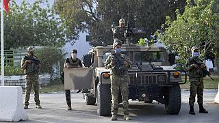 Tunisian soldiers cordon-off the Parliament in the capital Tunis, following a move by the president to suspend the country's parliament and dismiss the Prime Minister.