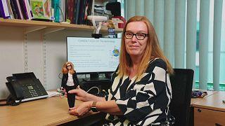 Professor Sarah Gilbert holding her new Barbie doll.