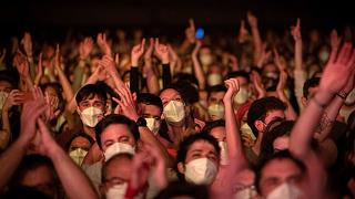 People take part in a music concert in Barcelona, Spain, Saturday, March 27, 2021.