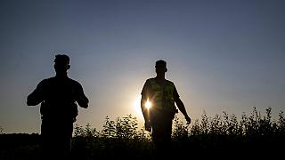 Members of the Lithuania State Border Guard Service patrol on the border with Belarus, near the village of Purvenai, Lithuania