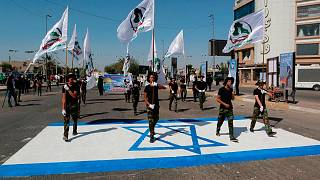 """مسيرة لقوات الحشد الشعبي العراقي على رسم لعلم إسرائيلي خلال يوم """"القدس""""، بغداد، العراق، 31 مايو / أيار 2019"""
