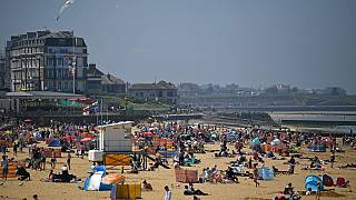 Sunbathers take advantage of the fine weather on the beach on the coast at Margate, east of London on May 31, 2021.