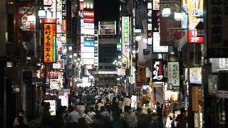FILE - In this July 16, 2021, file photo, people crowd the street in the Kabukicho area, Tokyo's entertainment district.