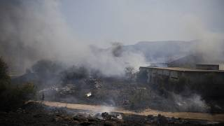 Fields burn following a hit by a rocket fired from Lebanon into Israeli territory, near the northern Israeli town of Kiryat Shmona, Wednesday, Aug. 4, 2021.