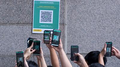 """Visitors scan a QR code for the Hong Kong government's """"Leave Home Safe"""" app to trace people in the advent of any Covid-19 outbreaks"""