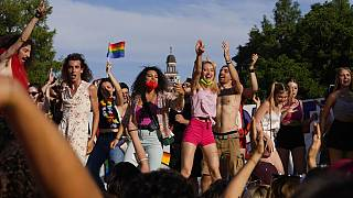 People take part in the annual Pride march, in Milan, Italy, Saturday, June 26, 2021