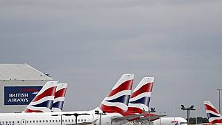 British Airways passenger planes are pictured at the apron at Heathrow Airport as the UK government's 14-day quarantine for international arrivals starts on June 8, 2020.