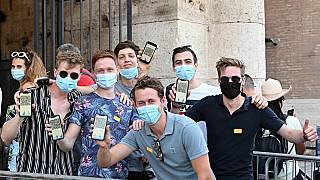 Visitors show their Covid-19 certificates before entering the Ancient Colosseum in Rome on August 6, 2021, as Italy made the Green Pass compulsory.